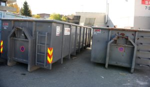 Bilde av grå krokcontainere, profilert med FIAS Proff